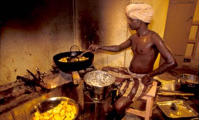 How is a cook selected in Kalayur village